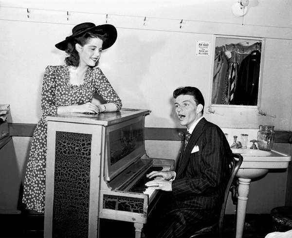 Frank Sinatra performs for Vivian Blaine on June