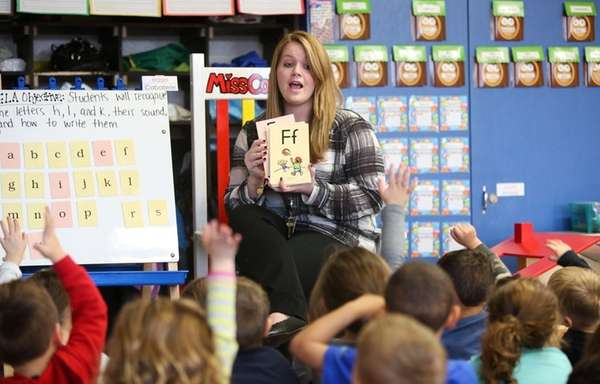 Paige Collman teaches her pre-kindergarten class at Lincoln