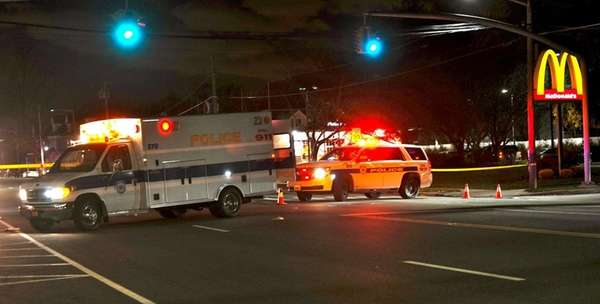 Police respond to the scene where a pedestrian
