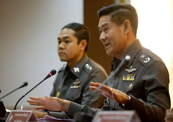 National police deputy spokesman Col. Songpol Wattanachai, right,