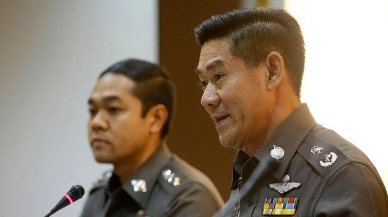 National police deputy spokesman Col. Songpol Wattanachai, right,