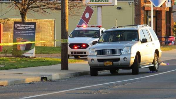 Suffolk County police investigate a car accident that