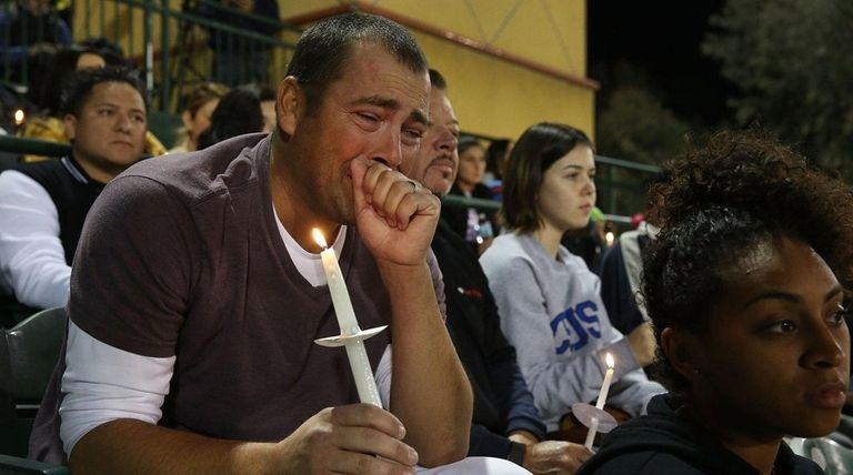 People attend a vigil at the San Manuel