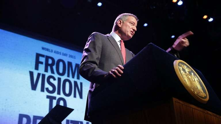 New York Mayor Bill de Blasio addresses a