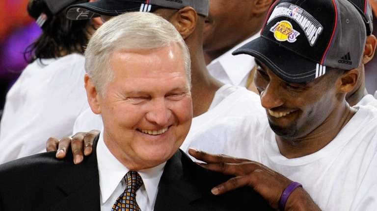 Los Angeles Lakers guard Kobe Bryant gives basketball