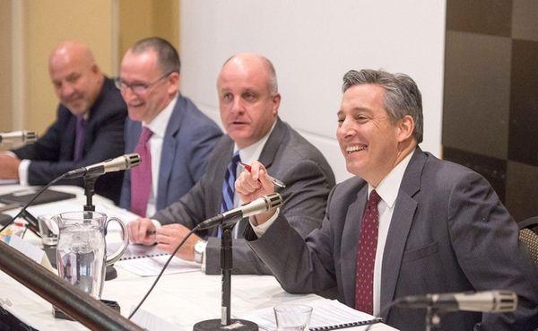 NIFA Chairman Jon Kaiman, right, smiles during a