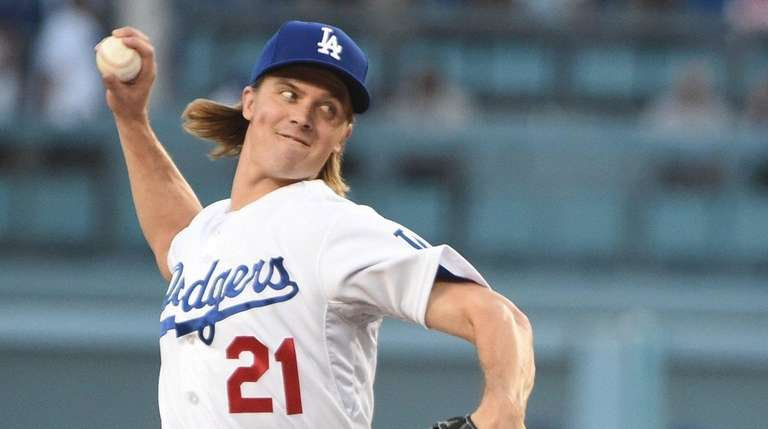 Los Angeles Dodgers pitcher Zack Greinke throws during