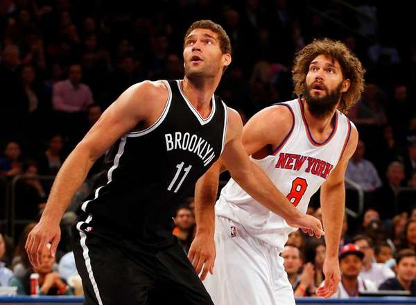 Brook Lopez of the Nets tries to drive