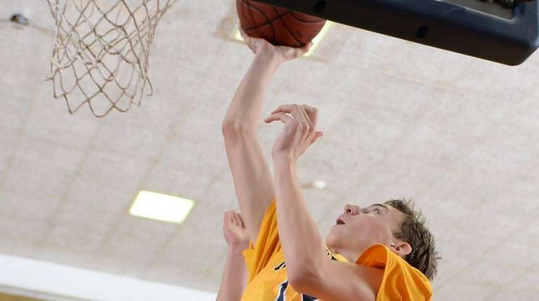 Massapequa's Kevin Voigt (13) with the layup during