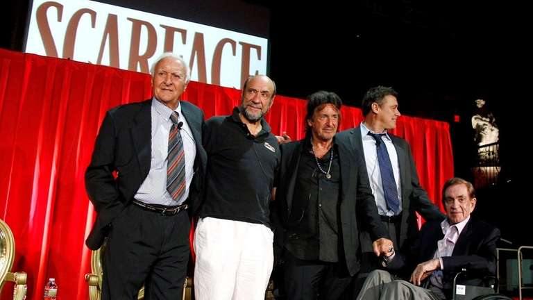 Actor Robert Loggia, far left, poses onstage druing
