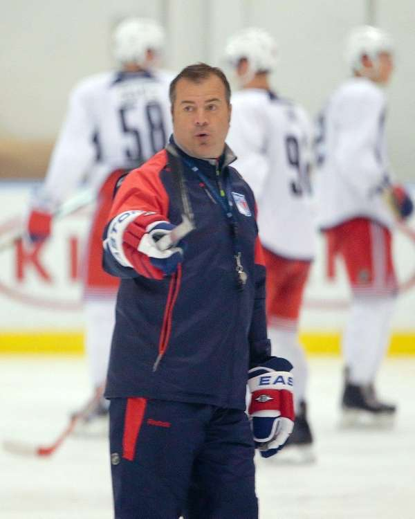 New York Rangers head coach Alain Vigneault instructs