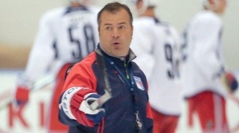 New York Rangers head coach Alain Vigneault instructs