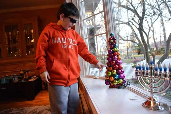 Nicholas Pelc, 9, of Smithtown examines all the