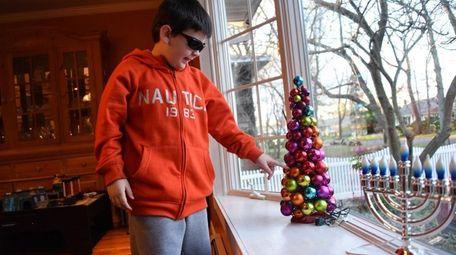 Nicholas Pelc, 9, of Smithtown examines all the