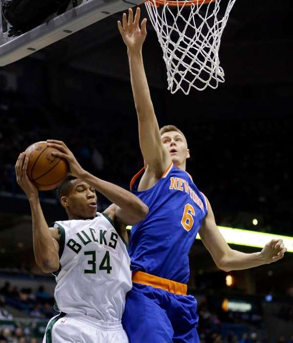 Milwaukee Bucks' Giannis Antetokounmpo (34) grabs a rebound