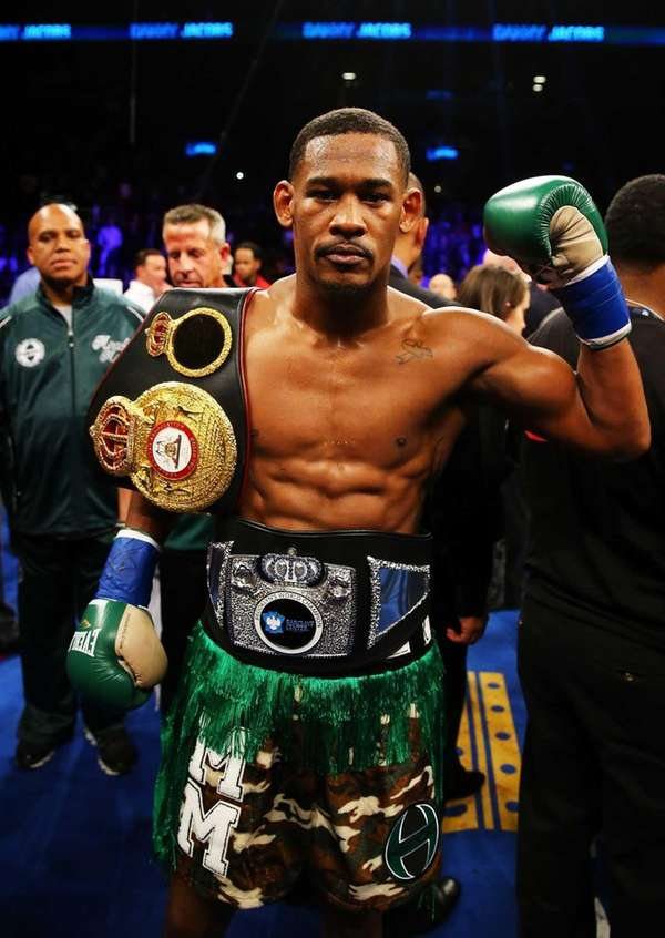 Danny Jacobs celebrates after defeating Peter Quillin during