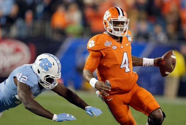 Clemson quarterback Deshaun Watson (4) runs the ball