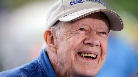 Former President Jimmy Carter answers questions during a