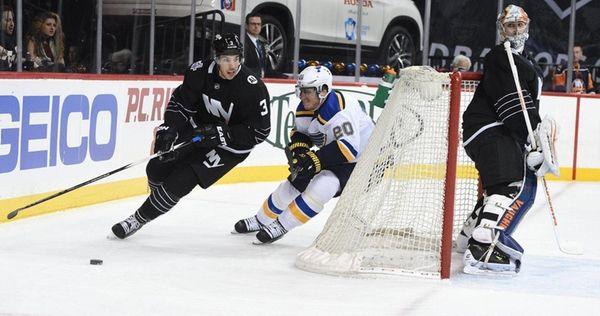 New York Islanders defenseman Travis Hamonic skates behind