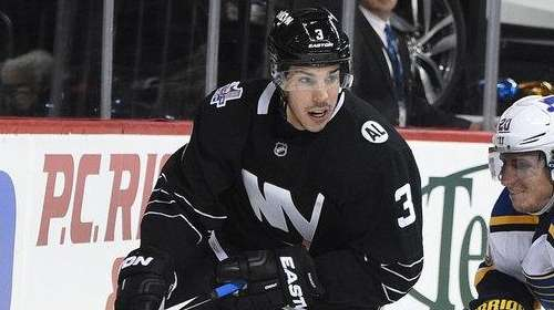 New York Islanders defenseman Travis Hamonic skates behind