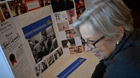 Denise Bundow, of Seattle, looks at a photo