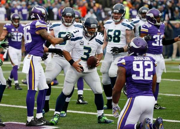 Seattle Seahawks quarterback Russell Wilson (3) celebrates his