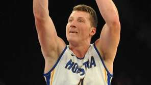 Rokas Gustys of Hofstra University shoots a free