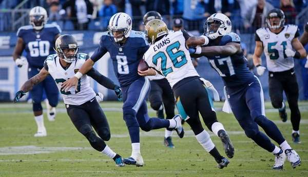 Tennessee Titans quarterback Marcus Mariota (8) gets past