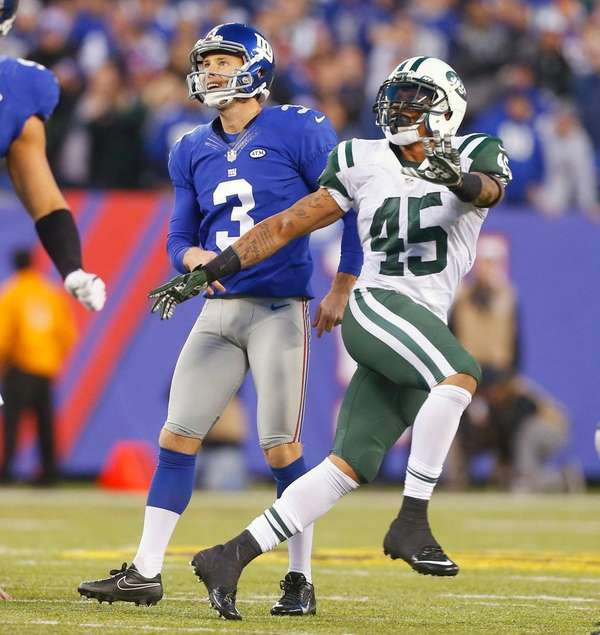 Giants' Josh Brown (3) and Jets' Rontez Miles