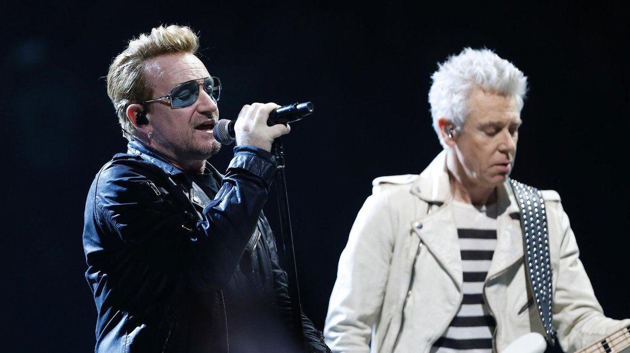 U2's Bono, left, and Adam Clayton perform onstage