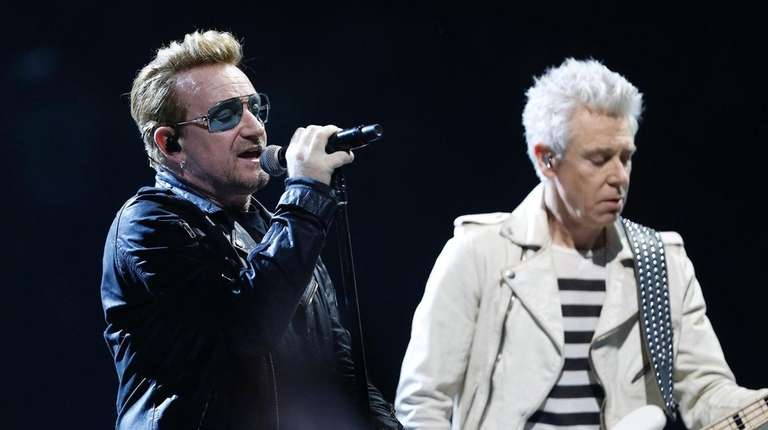 U2's Bono, left, and Adam Clayton perform onstage