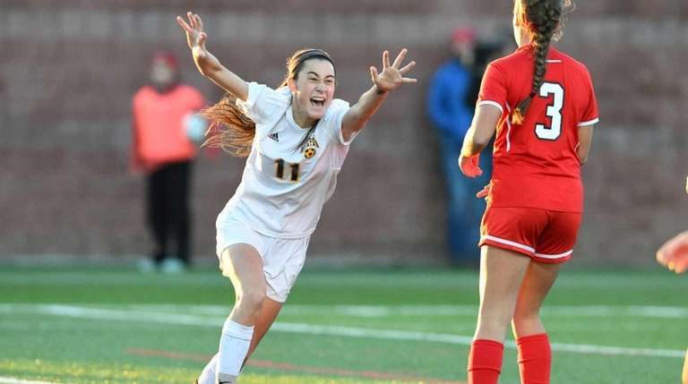Massapequa's Hope Breslin exults after booting the game-winning