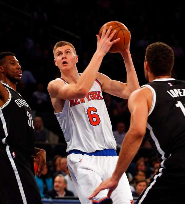 Knicks' Kristaps Porzingis puts up a shot against