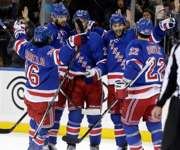 Derick Brassard, second from right, celebrates his goal