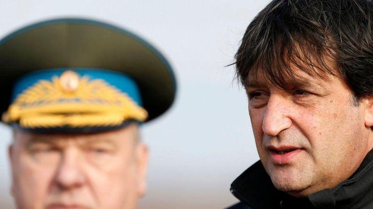 Serbian Defense Minister Bratislav Gasic, right, speaks in