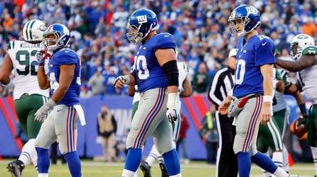 Eli Manning of the New York Giants walks