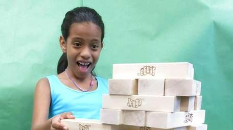Kidsday reporter Kimberly Napoli tested Jenga Giant.