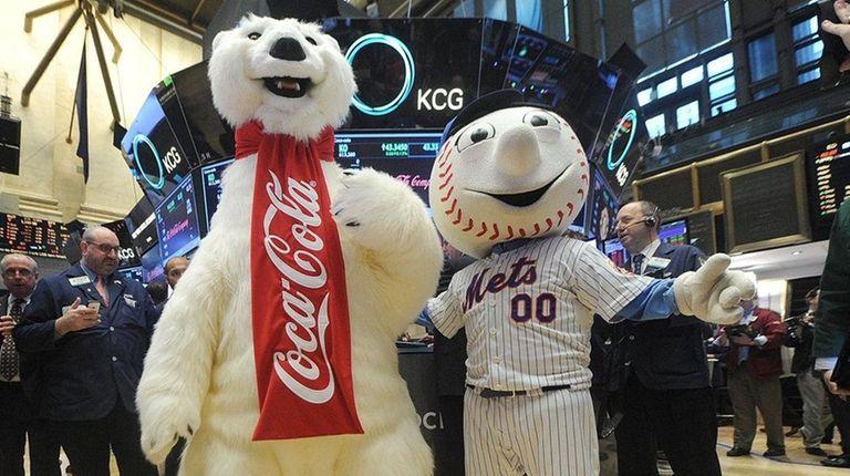 The Coca-Cola Polar Bear and Mr. Met pose
