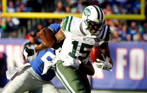 New York Jets wide receiver Brandon Marshall runs