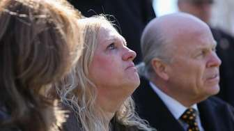 Mari Gilbert sheds tears during a memorial for