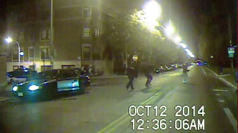 Ronald Johnson, right, is seen running from