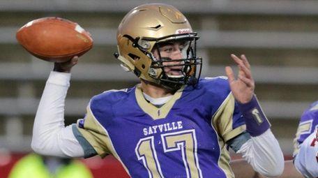 Sayville quarterback Jack Coan completes a pass for