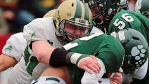 Longwood's Matt Weiss makes a tackle against Lindenhurst