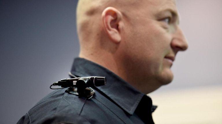 Freeport police officer Jason Zimmer demonstrates the use