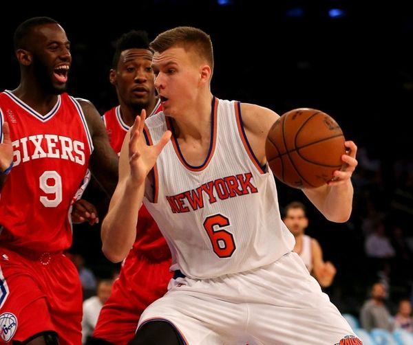 Knicks' Kristaps Porzingis makes his move against 76ers'