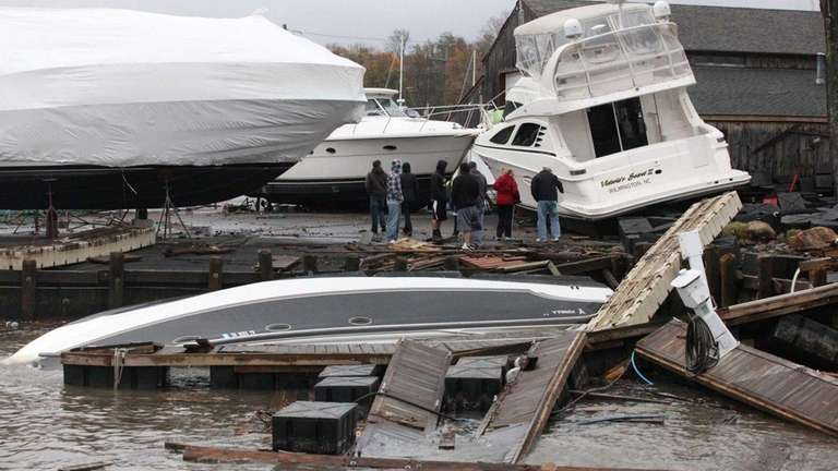 Boat owners survey the damage caused by Hurricane