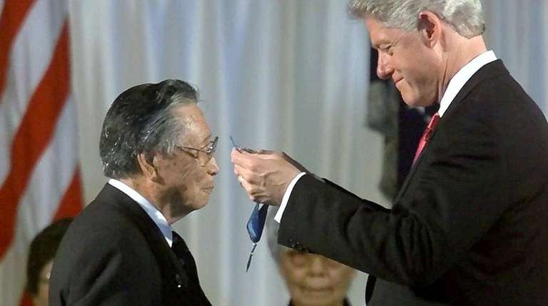 President Clinton presents the Medal of Honor to