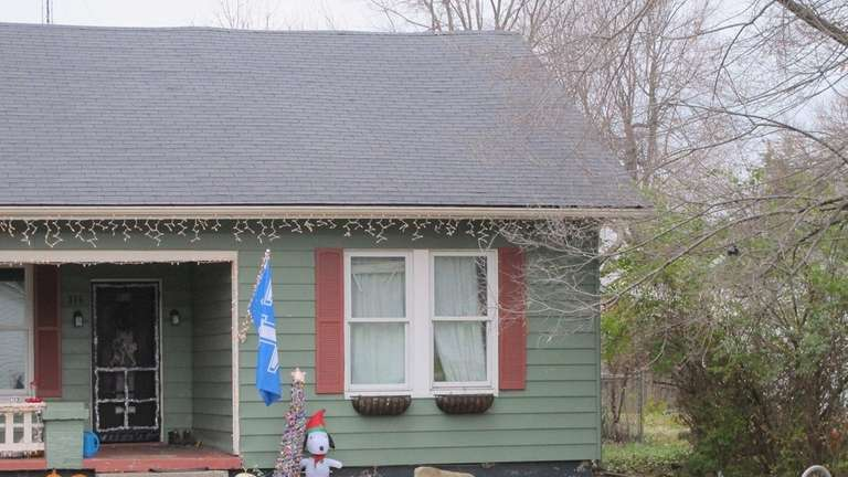 Christmas decorations adorn the house in Versailles, Ky.,