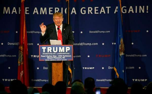 Donald Trump speaks during a rally aboard the