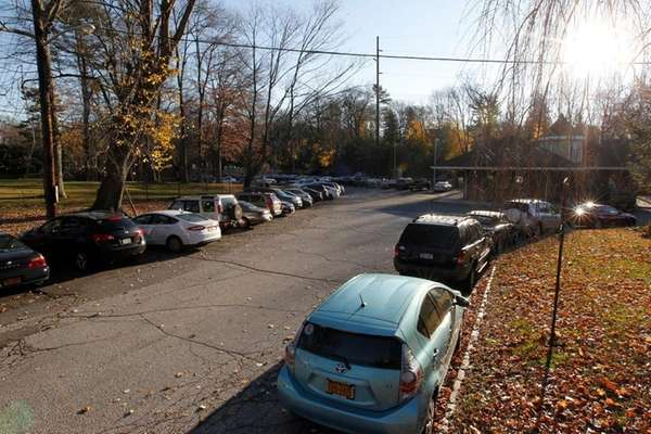 Vehicles fill the parking field at an LIRR